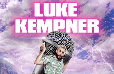 Luke holding a microphone