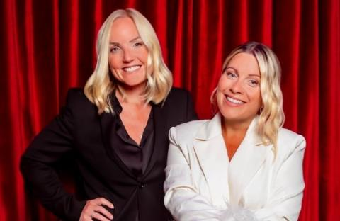 Stars of The West End Kerry Ellis and Louise Dearman in front of a red background.