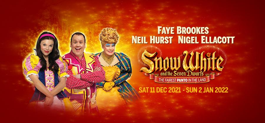 Faye Brookes, Neil Hurst and Nigel Ellacott in bright, colourful panto costumes.